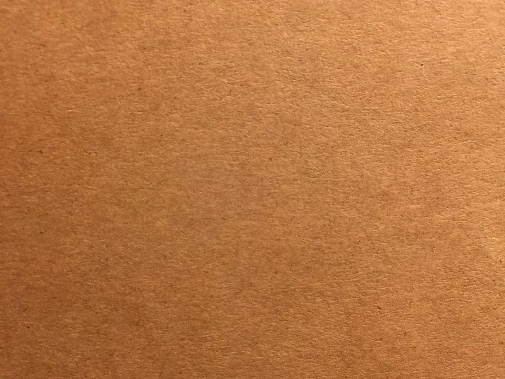 Golden brown/tan paper fiber close up