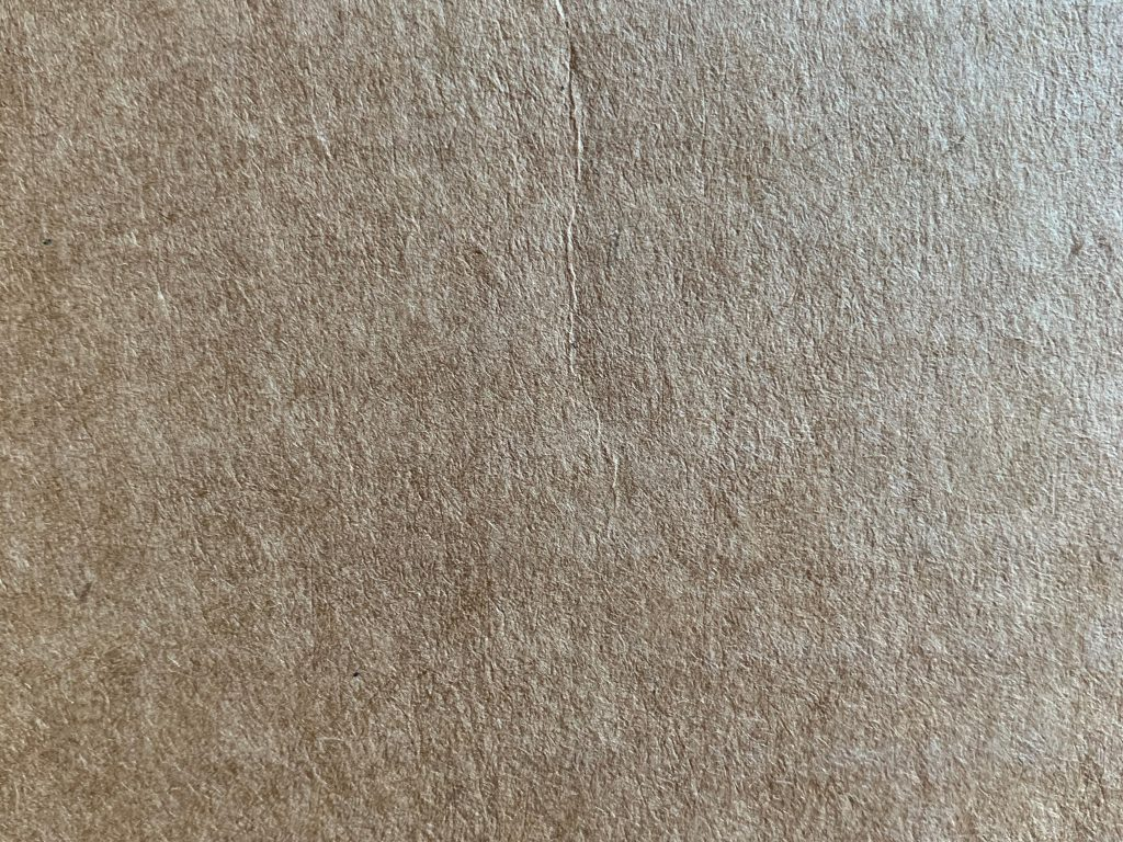 Light brown detailed shot of fine paper texture