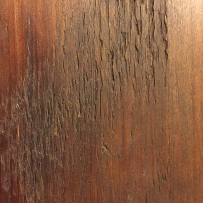 Dark brown stain on rough wood