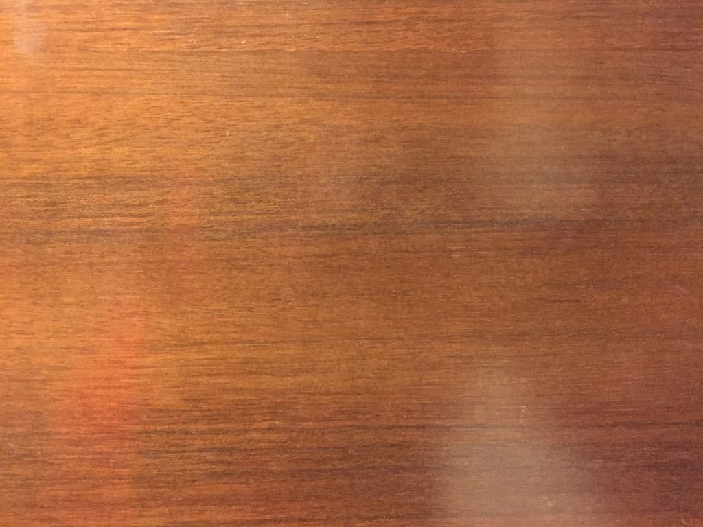 Cherry red stain on smooth wood surface