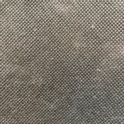 Extreme close up of dirty grey colored paper with visible corrugated pattern
