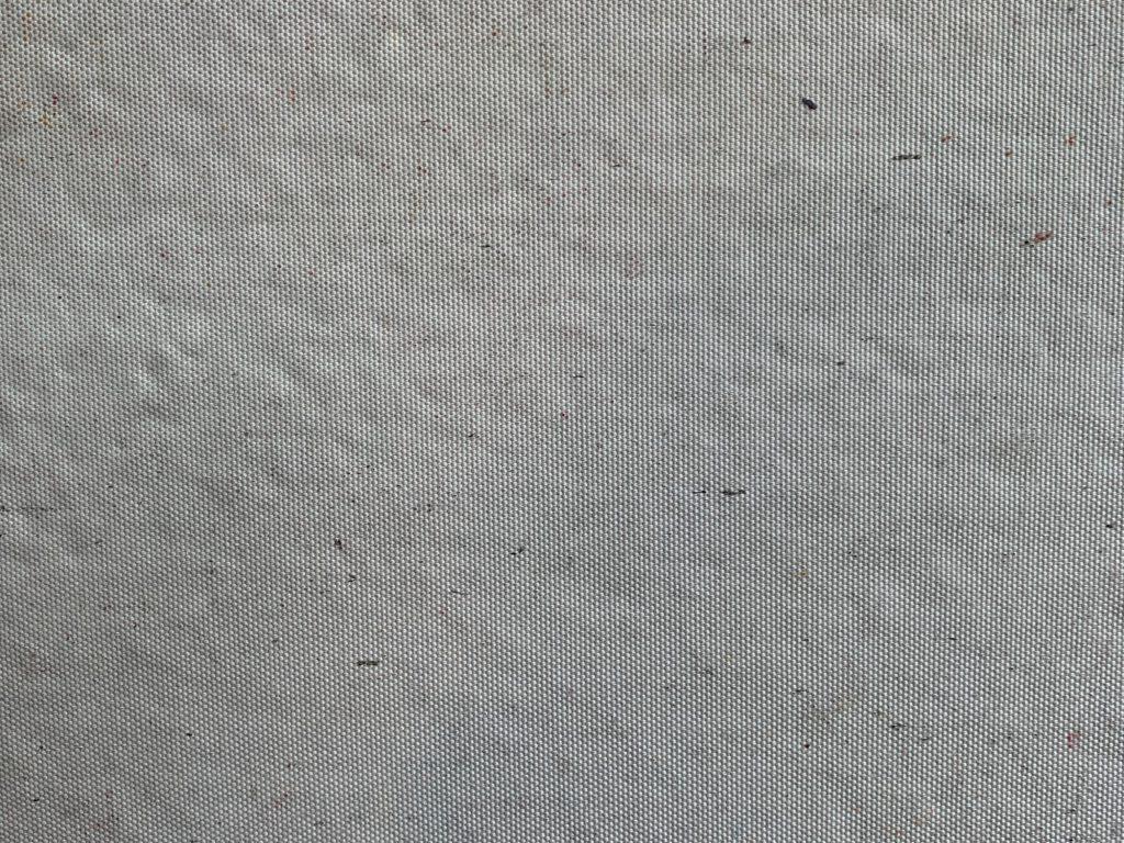 Close up of light grey dirty fabric