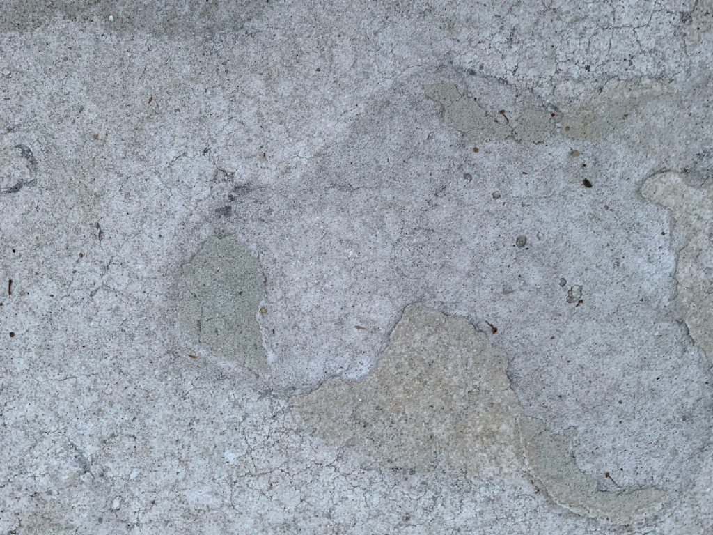 Pavement close up with layers of wear