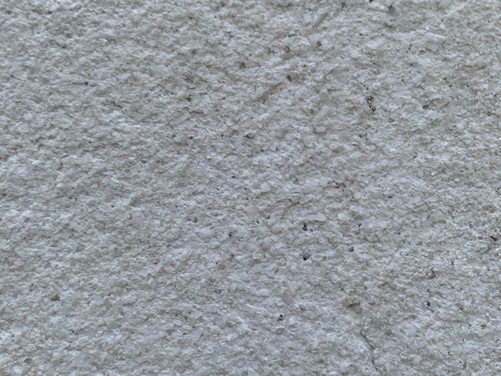 Close up of bumpy white rock wall