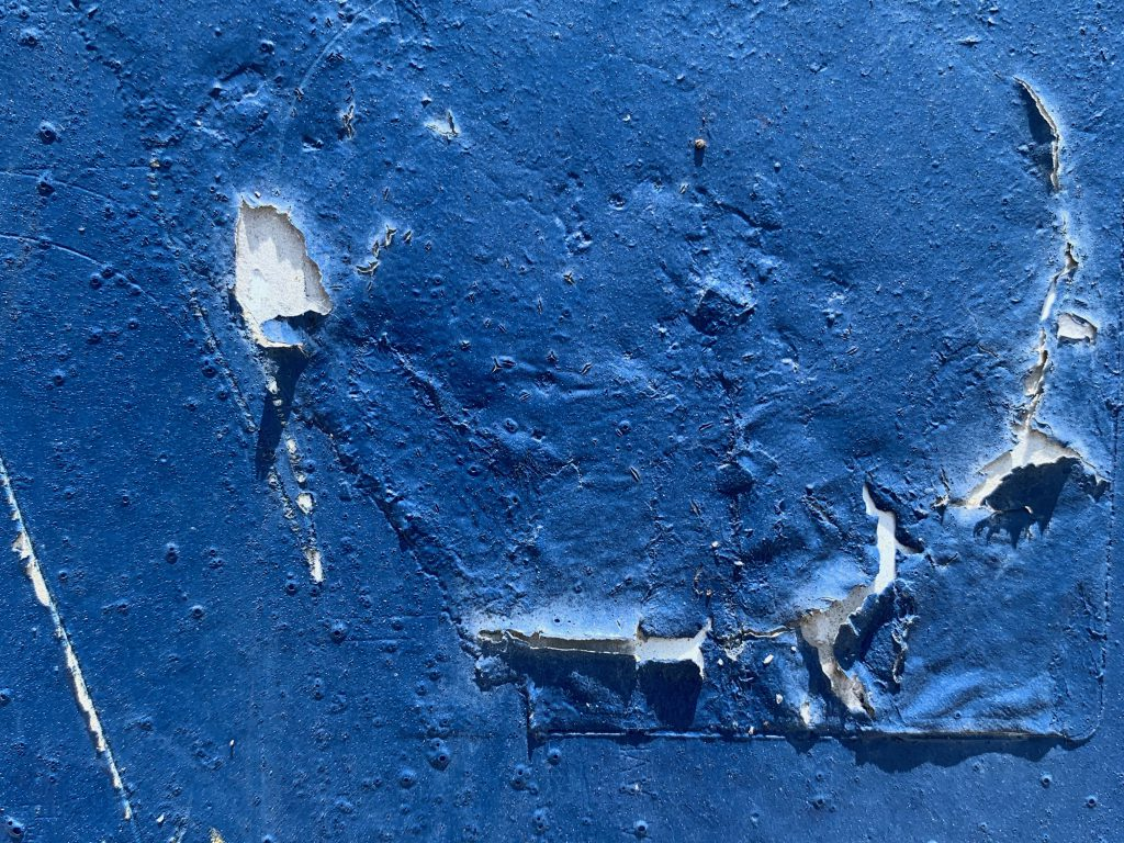 Flaking and cracking blue paint