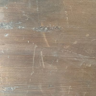 Wood board with scratches and dents