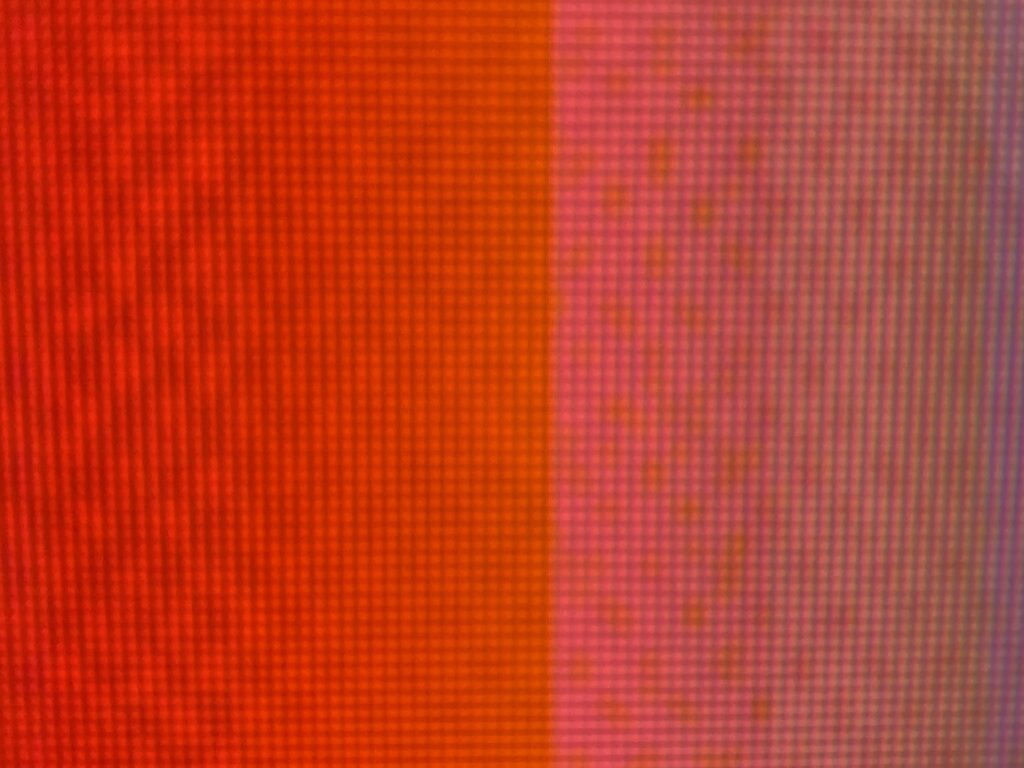 Bright red to pink pixel grid