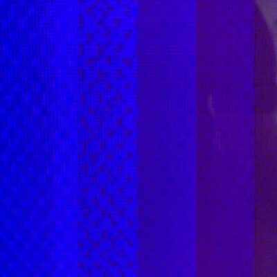 Vertical bars of varying hues of blue pixels