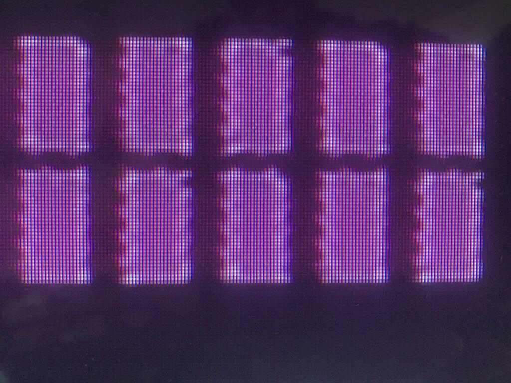 Bright purple rectangles over dark pixel background