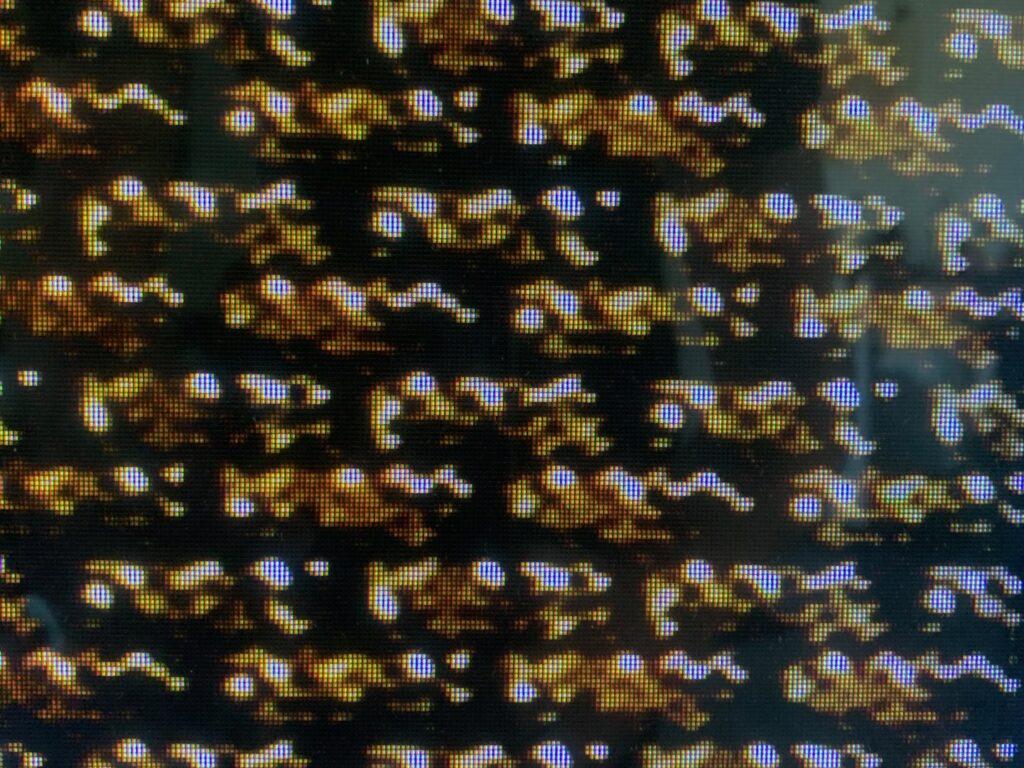 Golden brown pattern of digital shapes