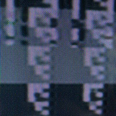 Close up of glitching grayscale retro video game tile