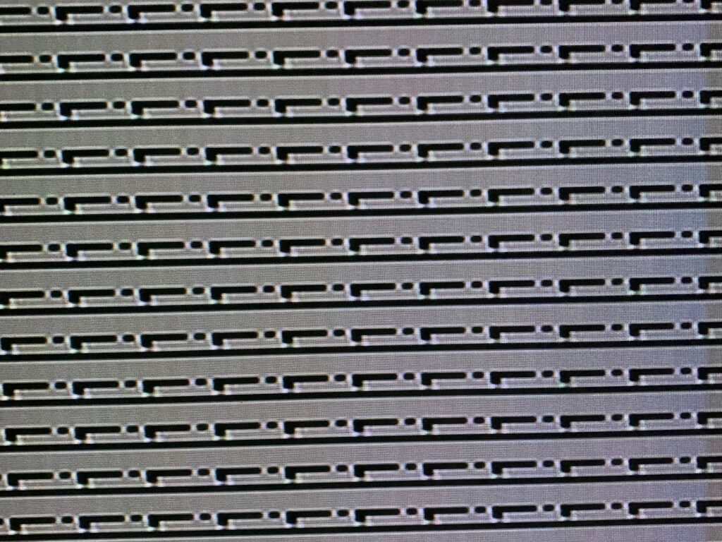 """Horizontal lines and """"L"""" shapes on black and white digital grid"""