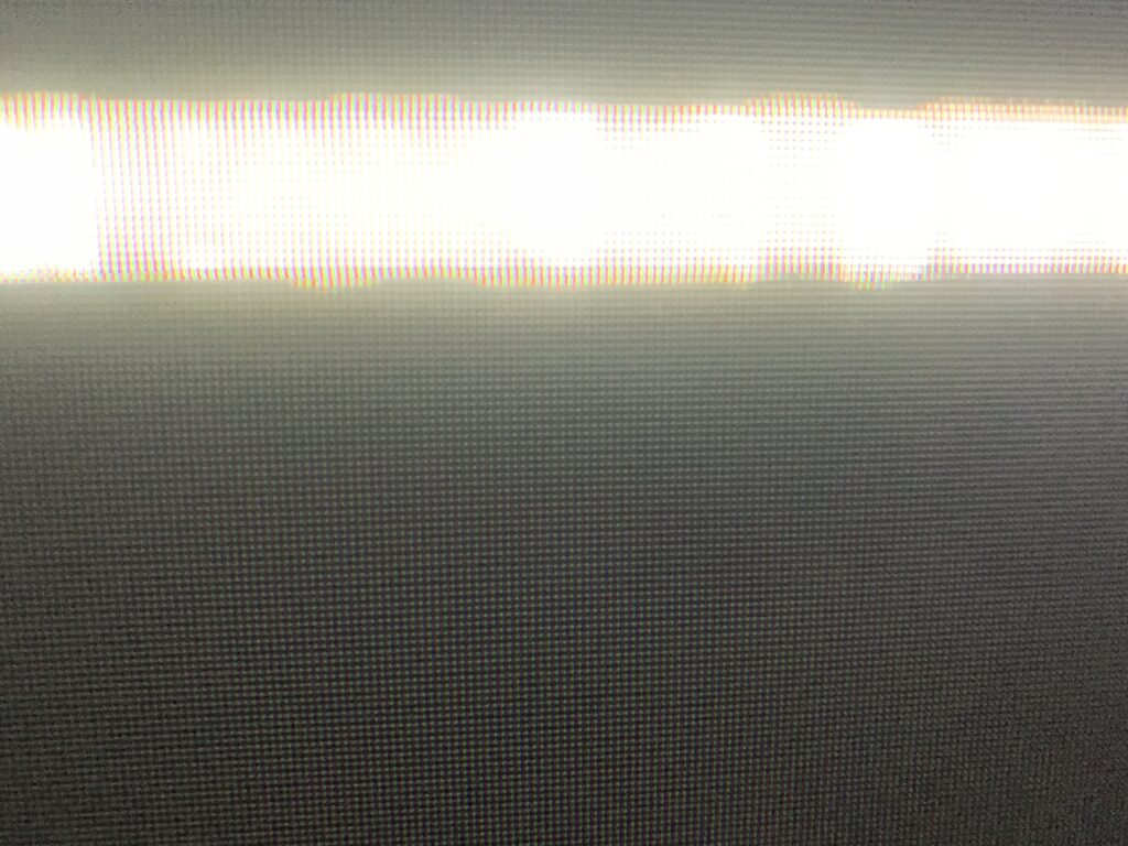 Bright white streak across dark grey LED pixel grid