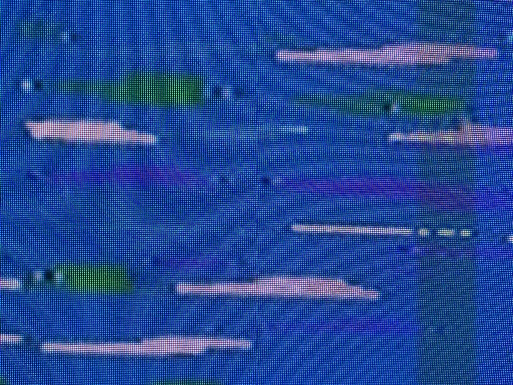 Jagged pink and green blotchy shapes over blue