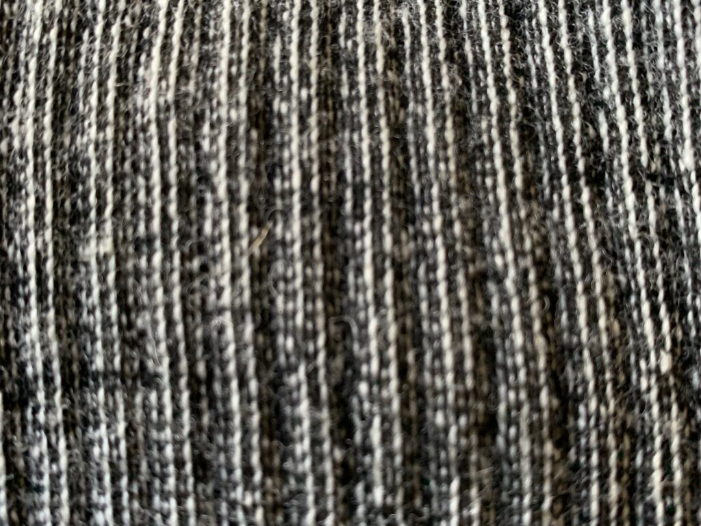 Charcoal gray wool close up stitching
