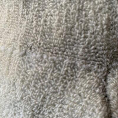 Soft white towel, slightly out of focus