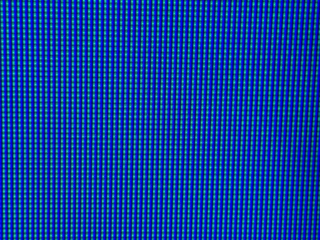 Green and blue digital lines creating vibrant grid