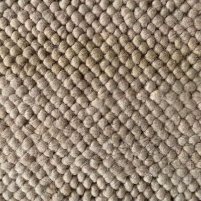 Close up off white worn down closed loop carpet