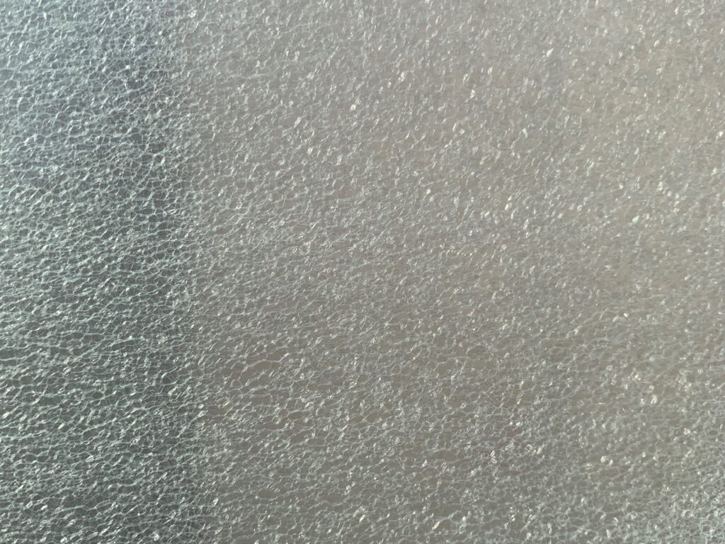White textured areas over gray plastic