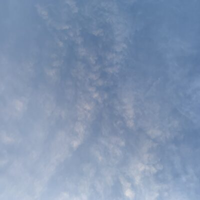 Blue sky with spattering of white clouds
