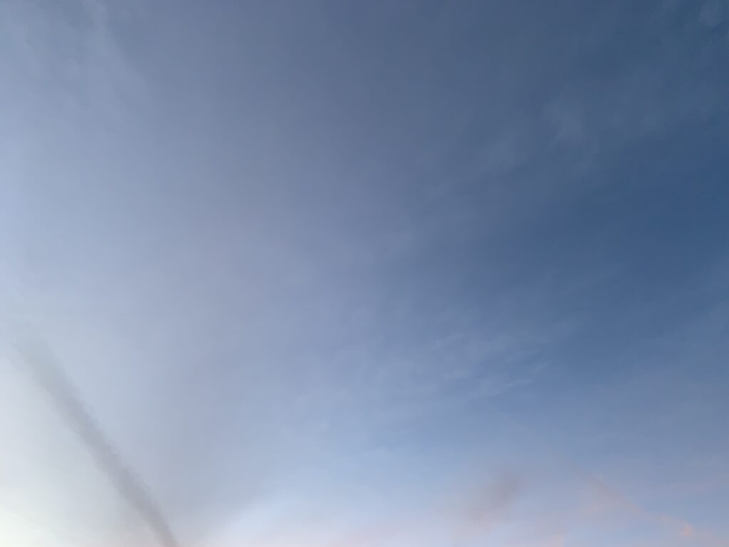 Subtle and thin layers of clouds over a bright blue sky