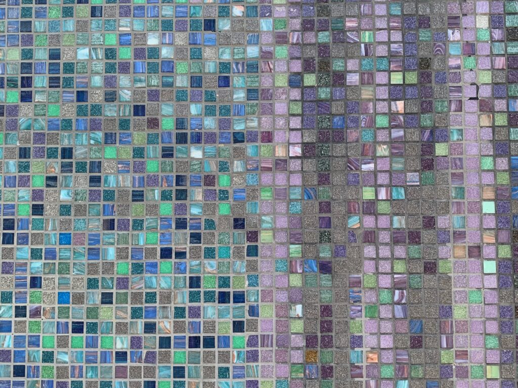 Thousands of small colorful glass tiles