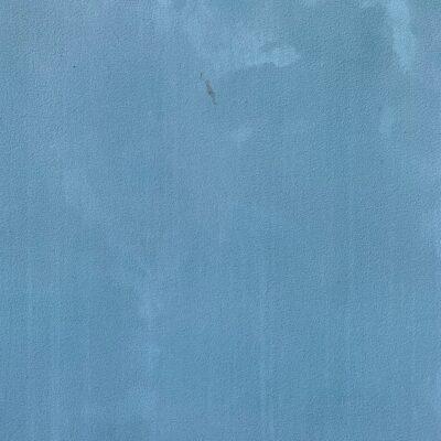 Coarse light navy blue wall