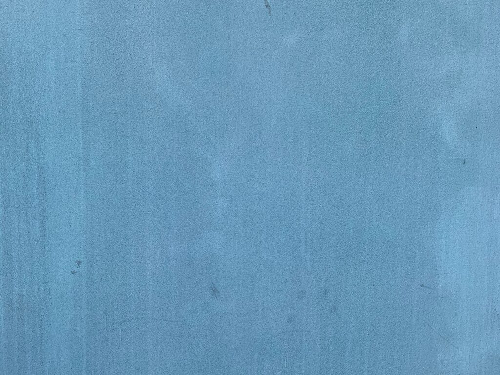 Dull blue wall with discoloration