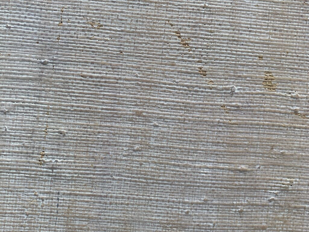 Bumpy white and light brown paint on wood