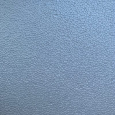 Baby blue foam with small circles covering surface