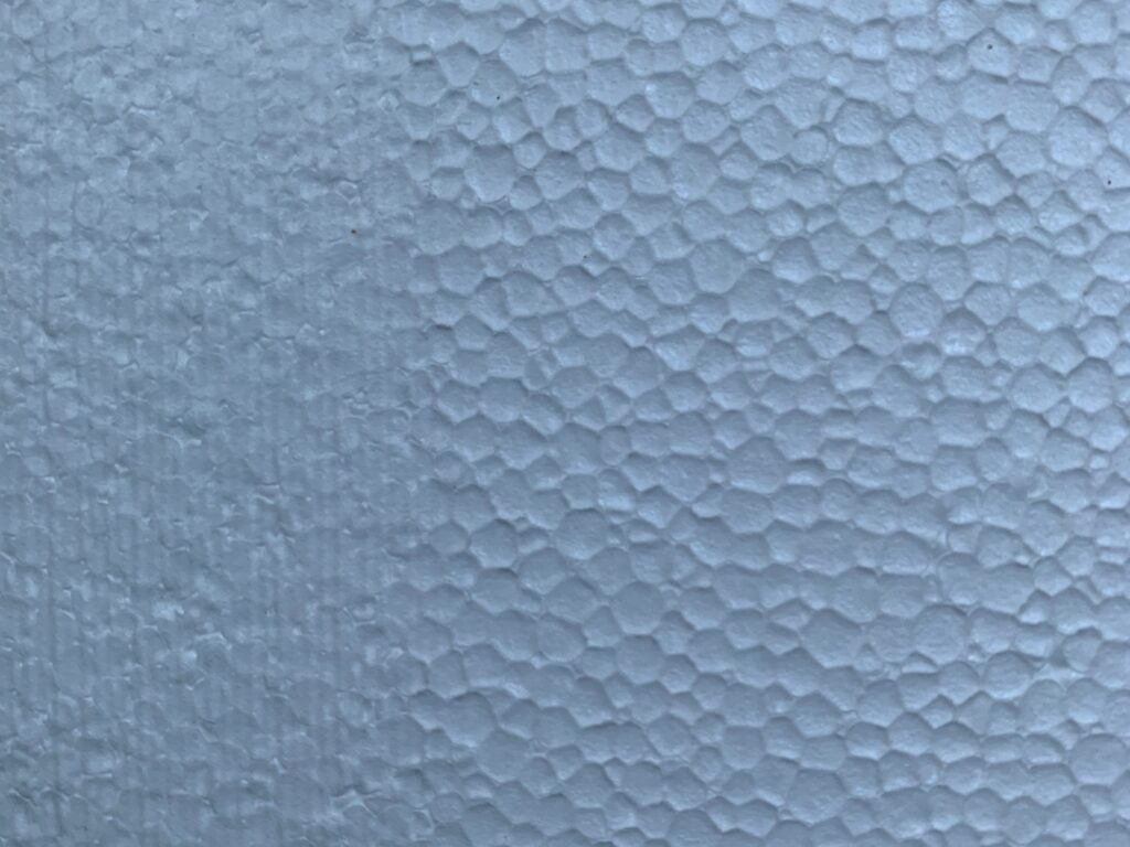 Close up foam surface with large circles and muted texture on left