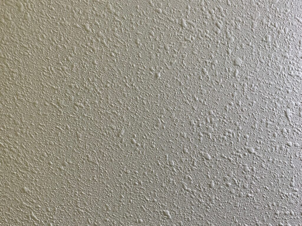 Bright specular on textured wall painted off-white