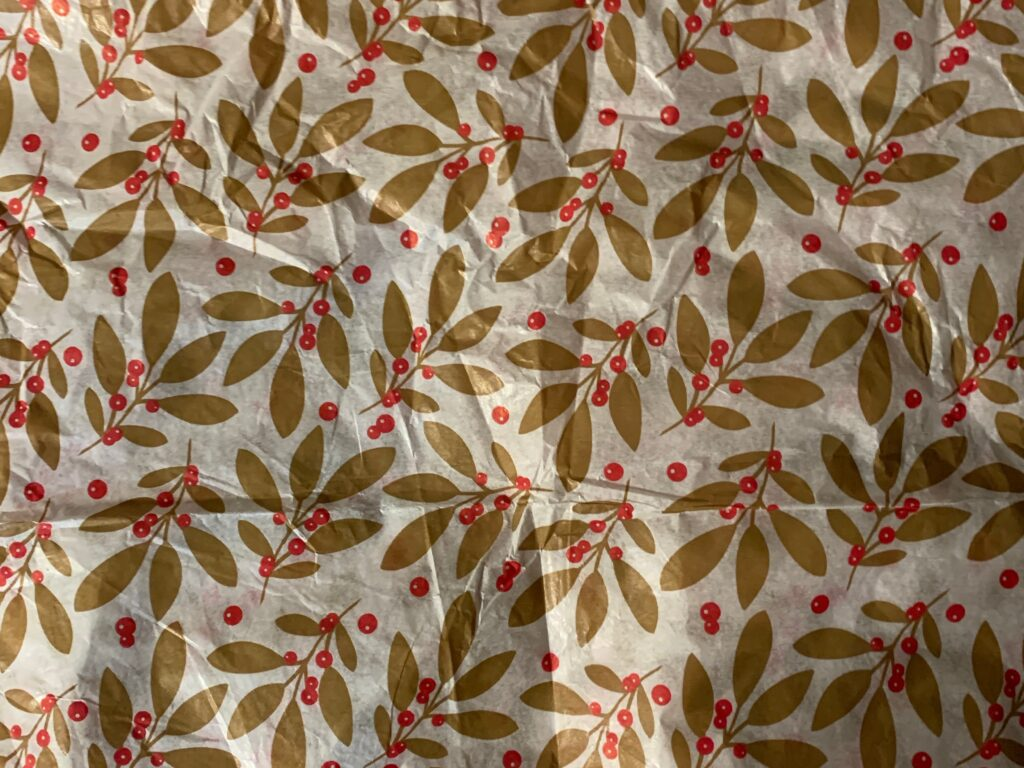 White decroative paper with printed pattern of gold leafs