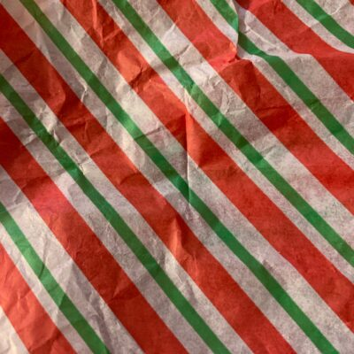 Vibrant diagonal red green and white stripes on paper