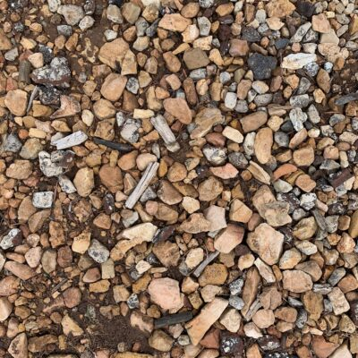 Muddy ground with a variety of rocks covering