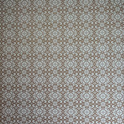 Decorative tiling with intricate pattern featuring white and brown
