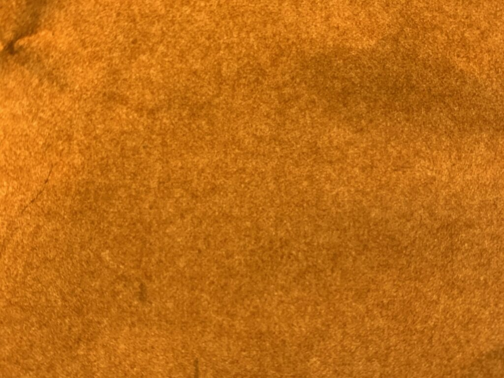 Close up of golden brown felt like paper