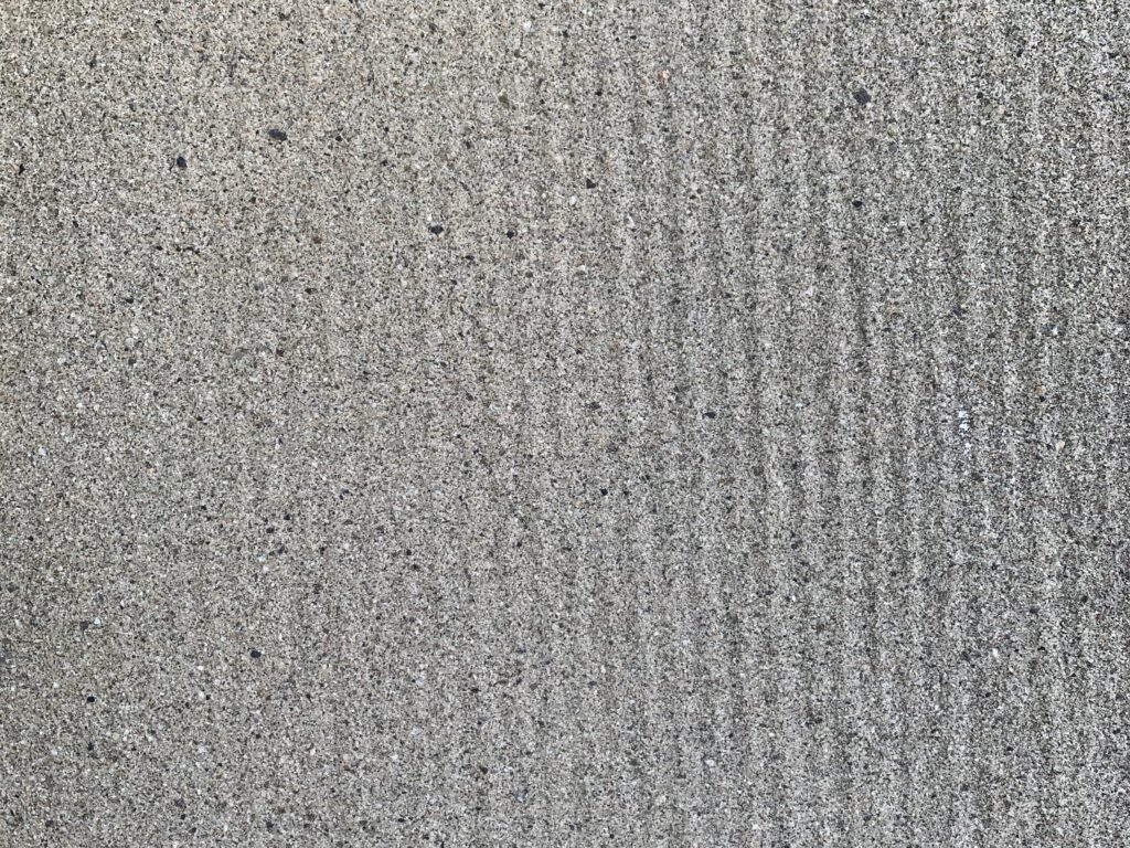 Coarse off-white sand with slight ripples